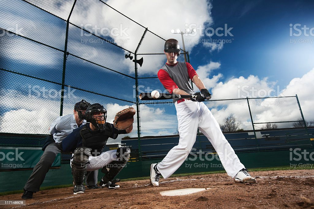Athletic Baseball Player Hitting Ball with Catcher and Umpire, Copyspace stock photo