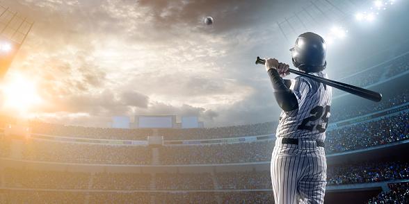 Baseball player hitting a ball in stadium