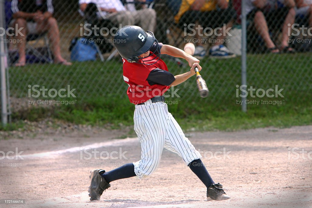 Baseball player hitting foul ball stock photo