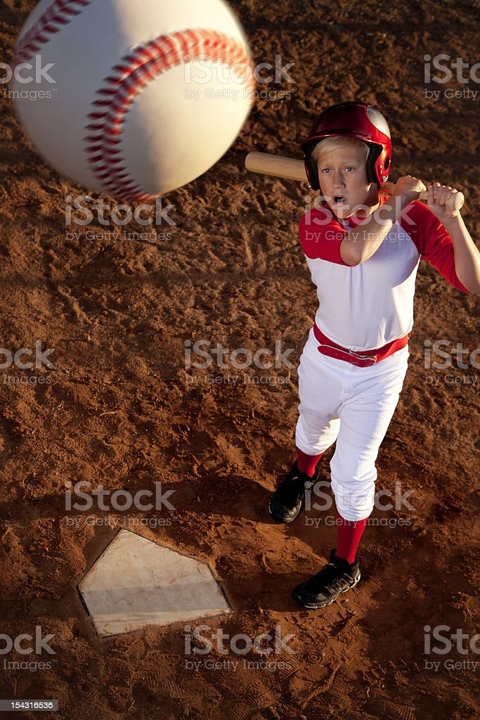Baseball Player Hitting the Ball stock photo