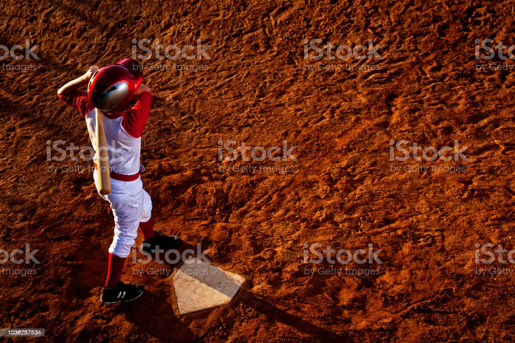 This is a photograph of a Little League hitter taken from the back...