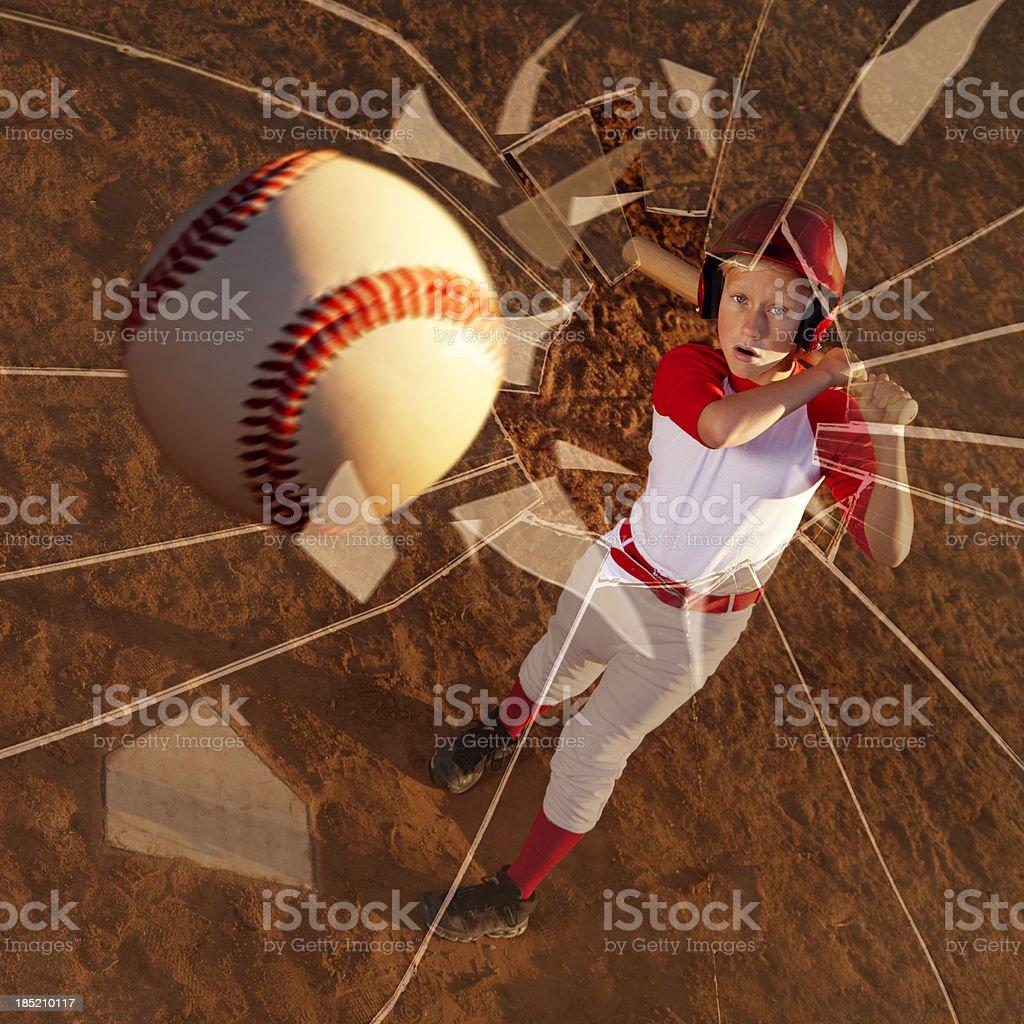 Baseball Player Hitting the Ball Through a Window stock photo