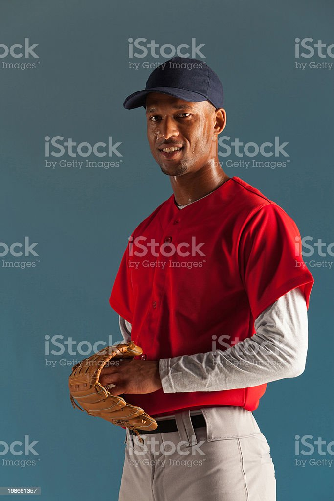 Baseball player holding ball and glove royalty-free stock photo