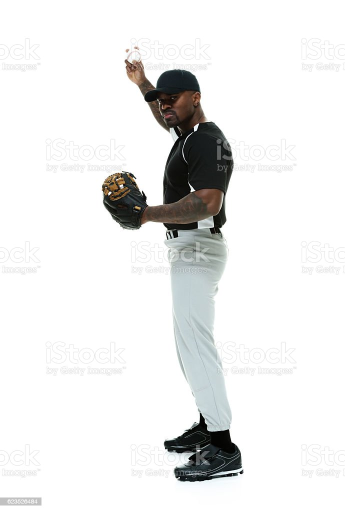 Baseball player holding  ball stock photo