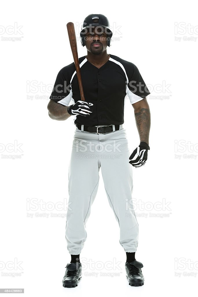 Baseball player holding bat stock photo