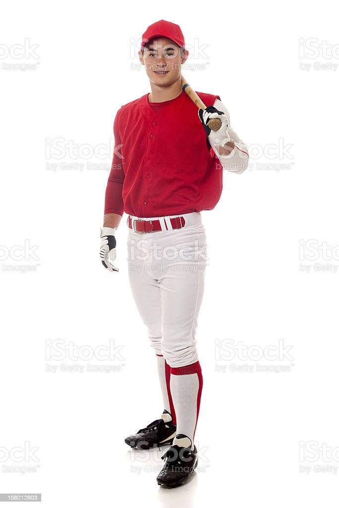 A baseball player in a white and red uniform stock photo