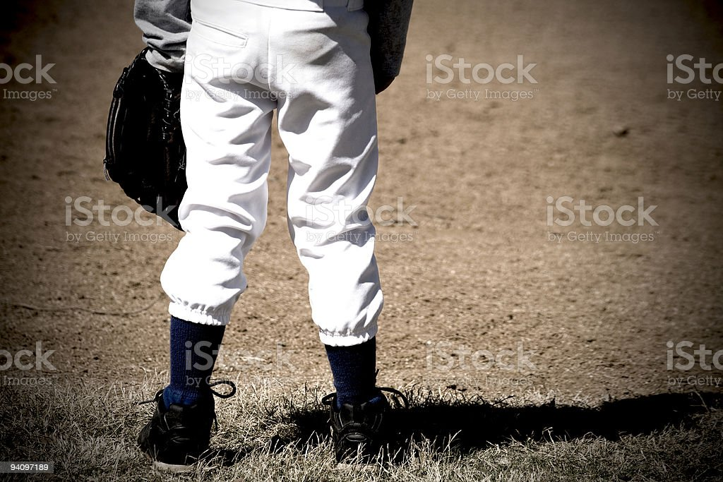 Baseball player in outfield, waiting. royalty-free stock photo