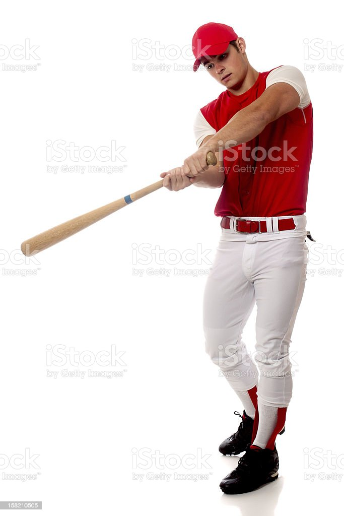 Baseball player in red cap holding a bat taking a swing stock photo