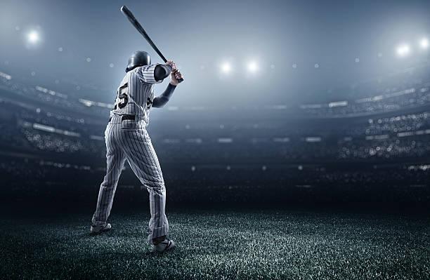 Baseball player in stadium stock photo
