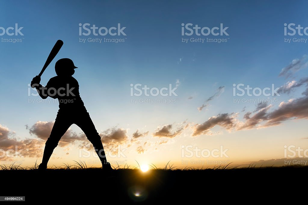 Baseball Player in the Sunset stock photo