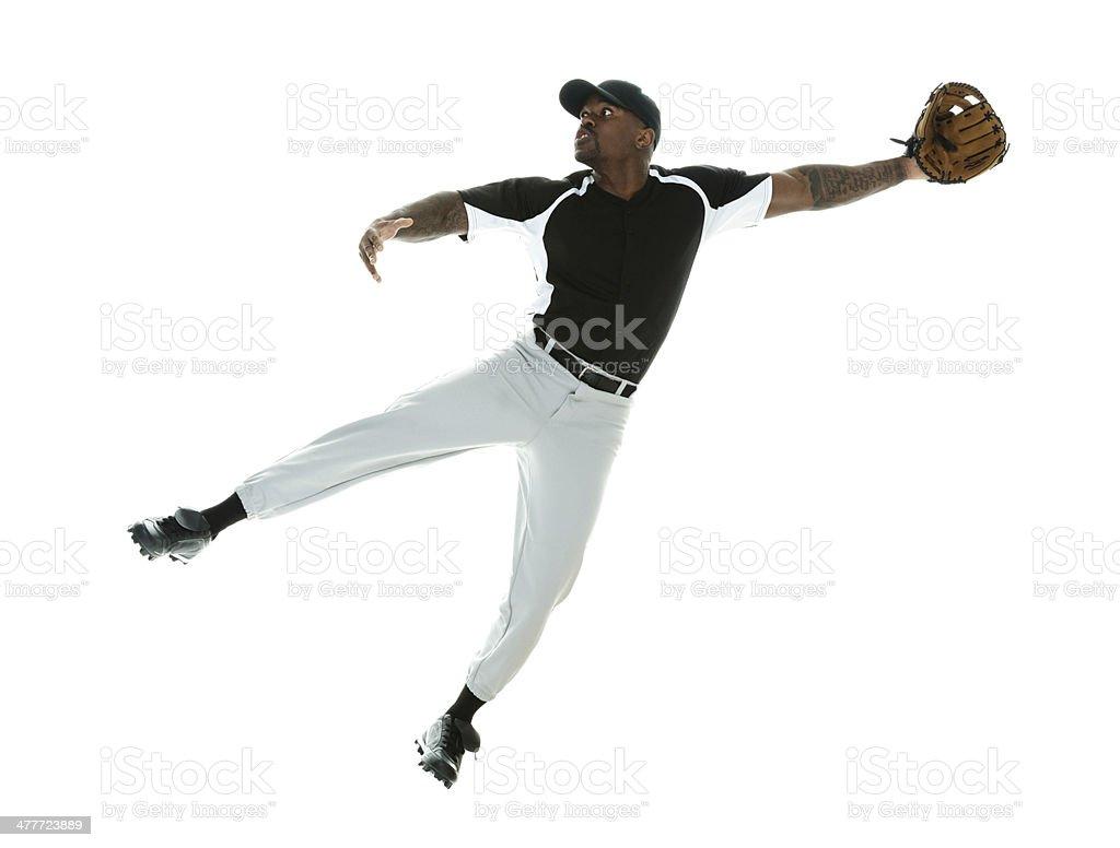 Baseball player jumping and catching stock photo