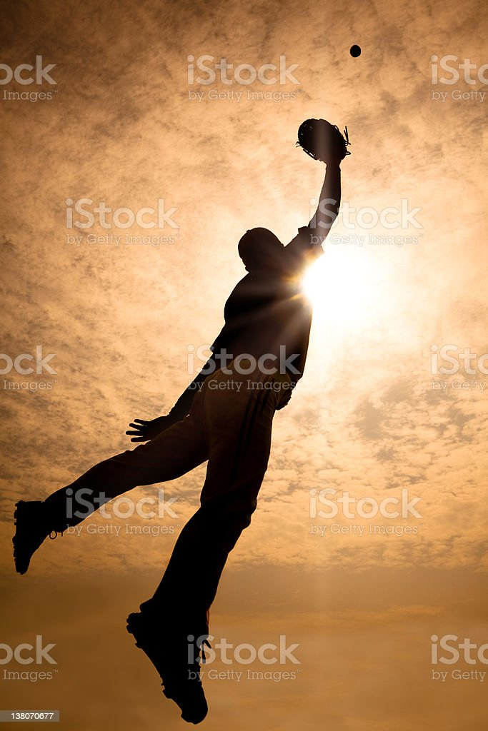 baseball player jumping and make the catch stock photo