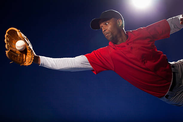 Baseball player lunging for ball  catching stock pictures, royalty-free photos & images