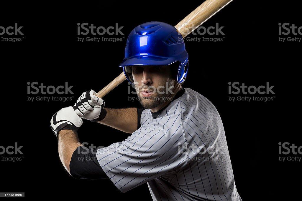 Baseball Player on a blue uniform stock photo