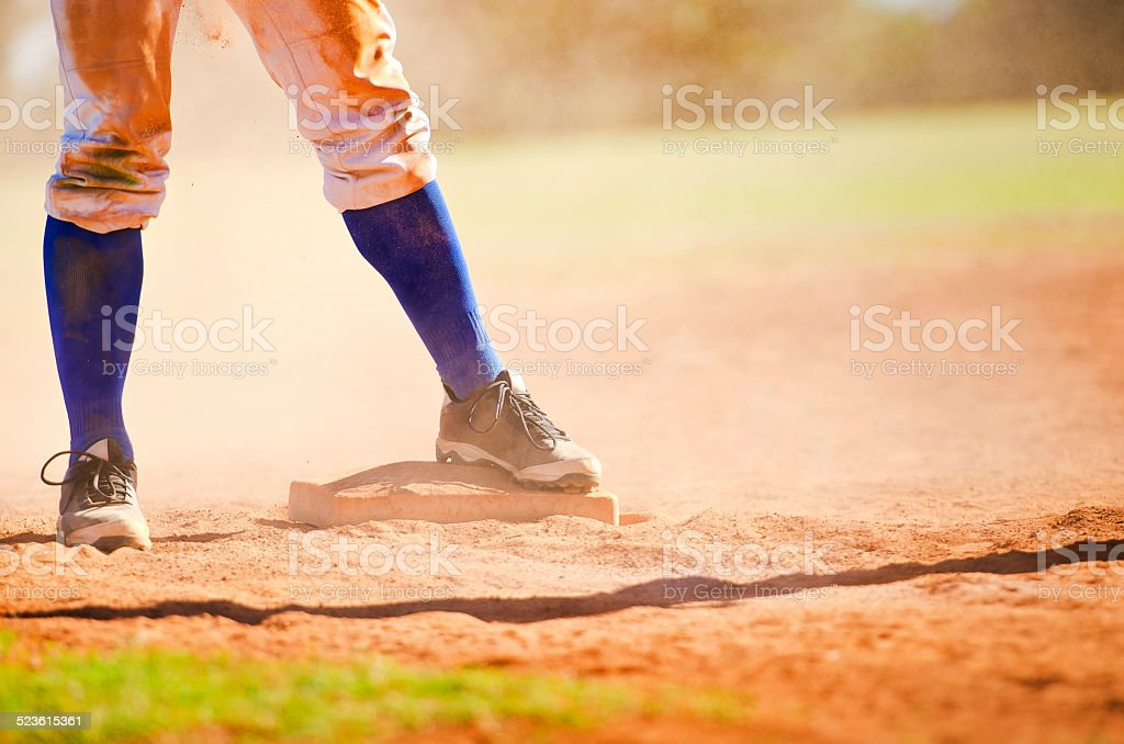 Baseball player on the base stock photo