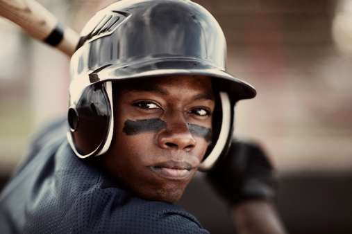 Close up of an African American baseball player who is ready to mash the ball.