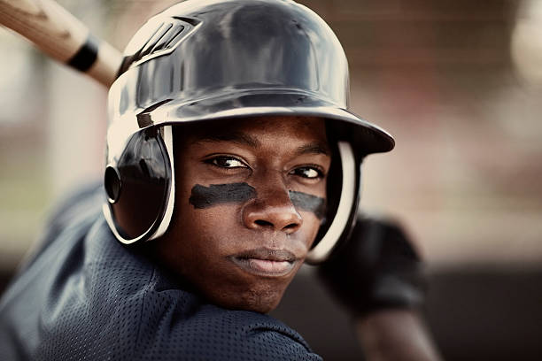 Baseball Player Close up of an African American baseball player who is ready to mash the ball. baseball sport stock pictures, royalty-free photos & images