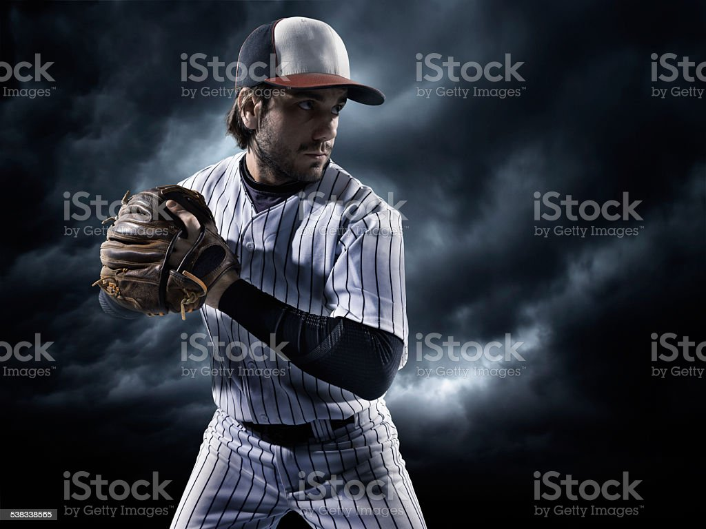 Baseball player about to strike ball during baseball game under...