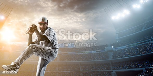 A male baseballs player makes a dramatic play by throwing a ball.  The stadium is blurred behind him. Only the lights of the stadium shine brightly, creating a halo effect around the bulbs.