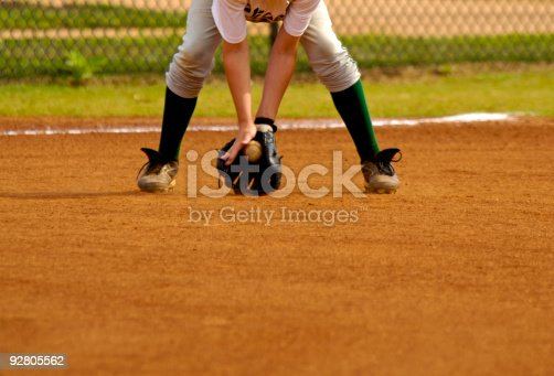 istock Baseball Player Playing in Live Baseball Game while Fielding Baseball 92805562
