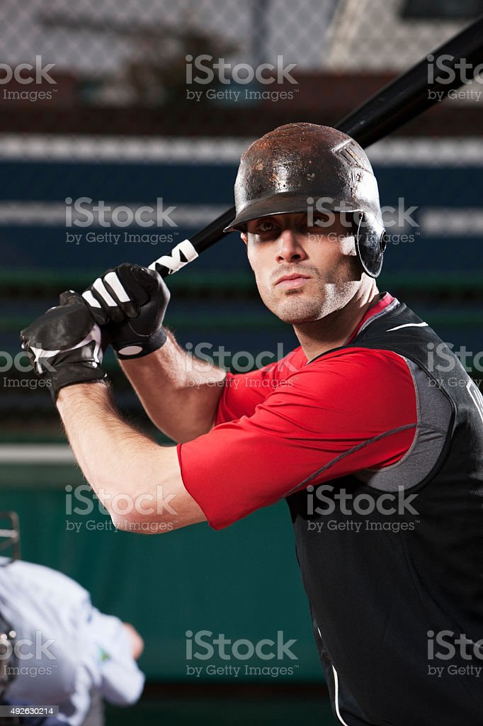 Baseball Player Portrait with Bat at Home Plate, Copy Space royalty-free stock photo