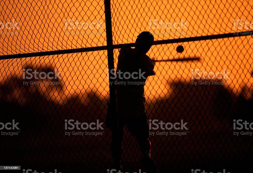 A baseball player practicing batting stock photo