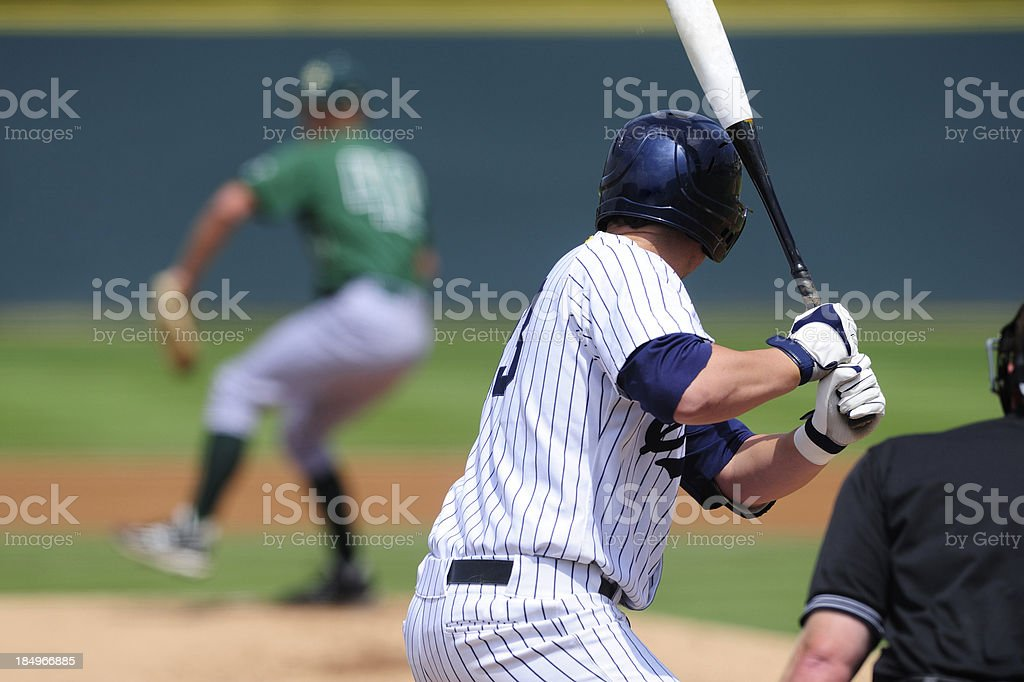 A baseball player preparing to swing his bat  stock photo