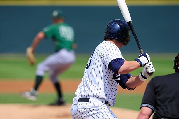 A baseball player preparing to swing his bat  stock photo