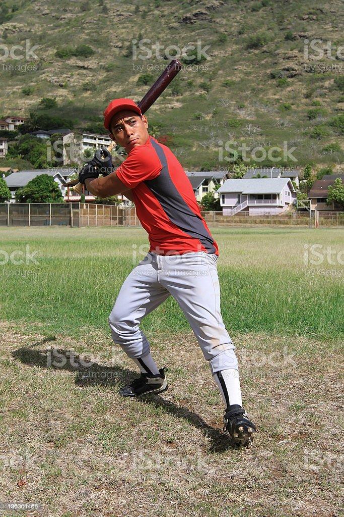 Baseball player ready to swing the bat stock photo