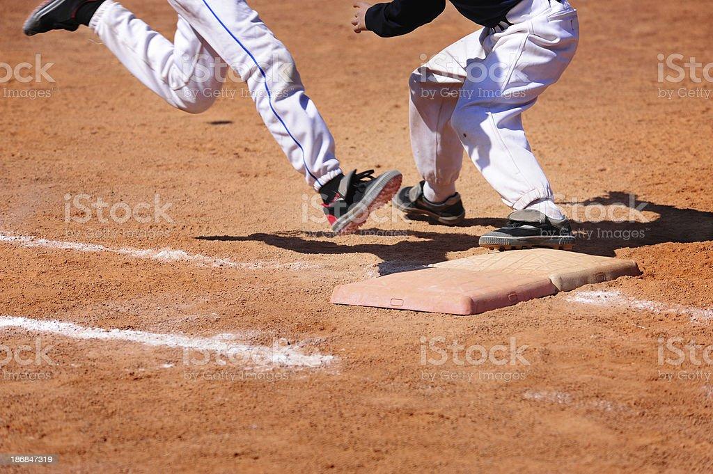 Baseball Player  running Slides Into Base diamond royalty-free stock photo