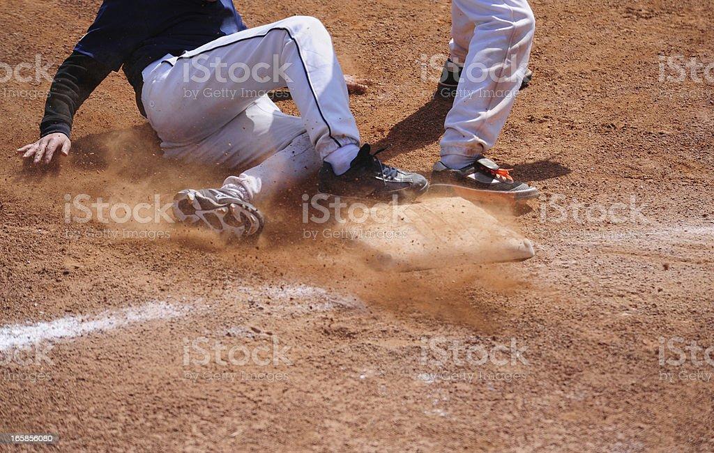 Baseball Player running  sliding Into Base stock photo