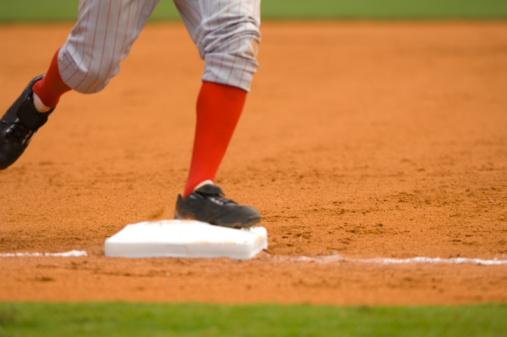 Baseball Player Running to First Baseball during Baseball Game
