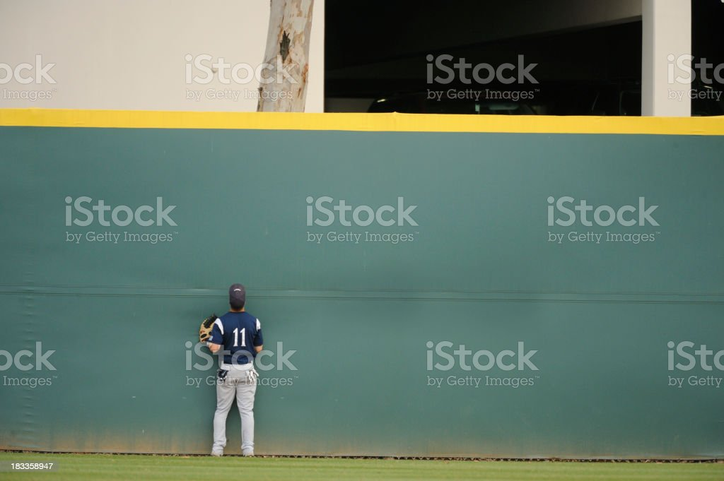 A baseball player searching desperately for his ball stock photo