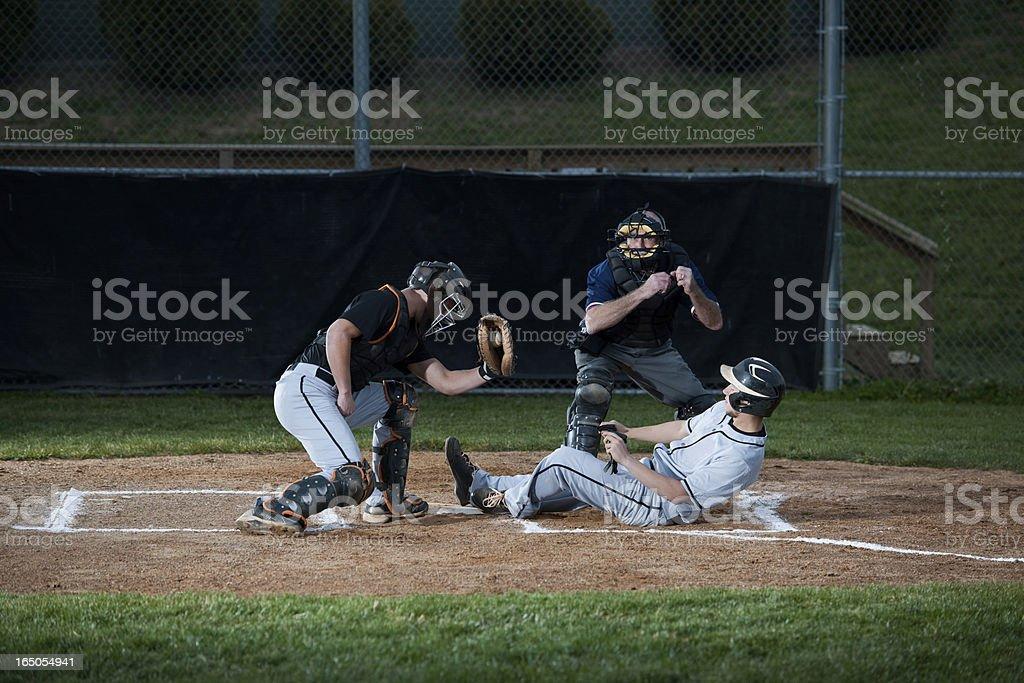 Baseball Player Slides Into Home Plate stock photo