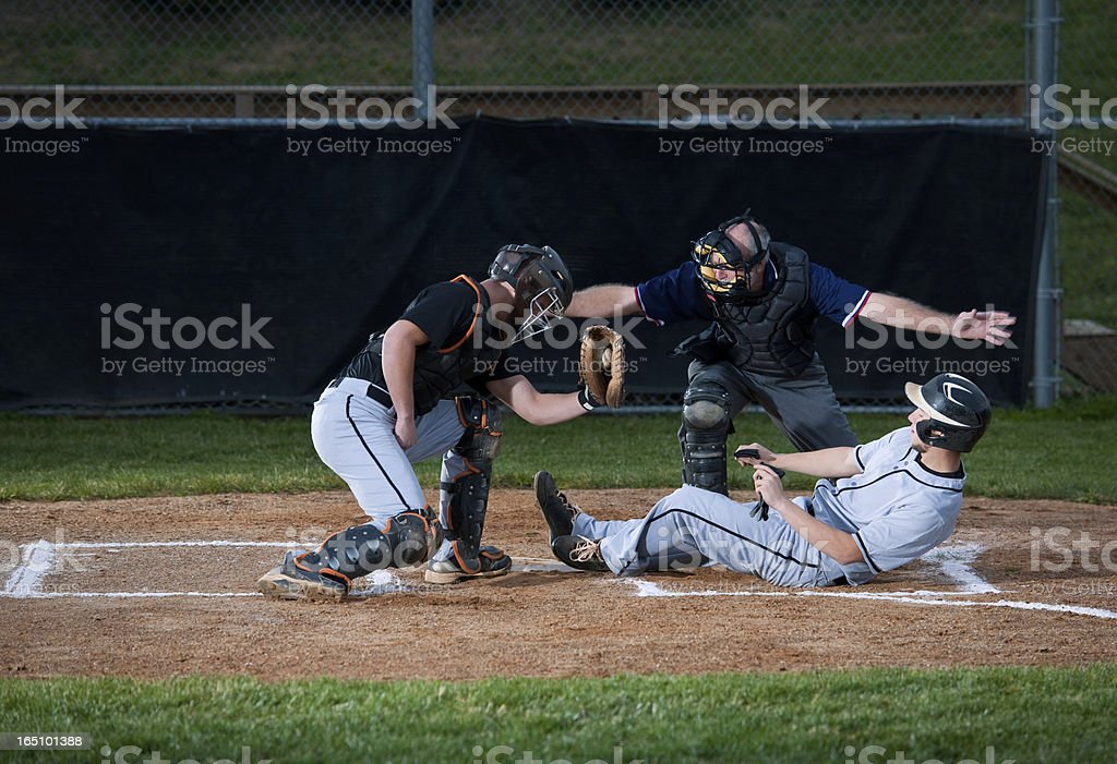 Baseball Player Slides Into Home Plate stock photo