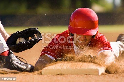 istock Baseball Player Sliding Into Base 485509615