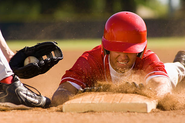 baseball player sliding into base - sliding stock photos and pictures