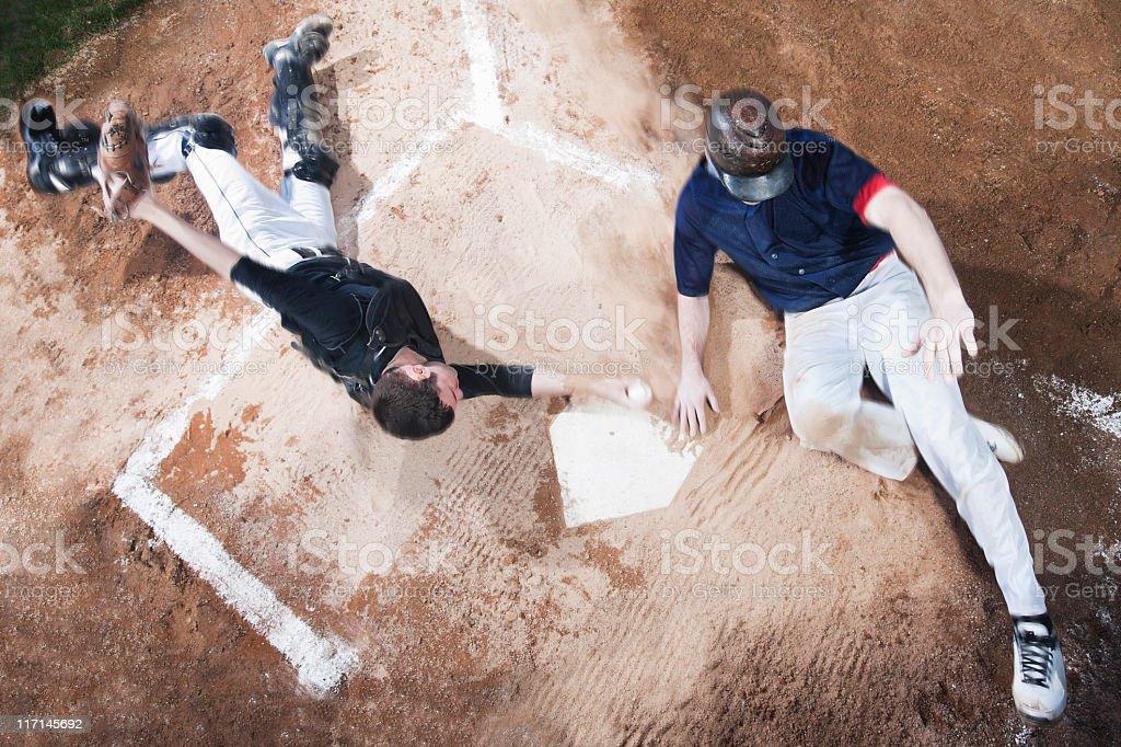 Baseball Player Sliding Into Home Plate, High Angle, Copy Space stock photo