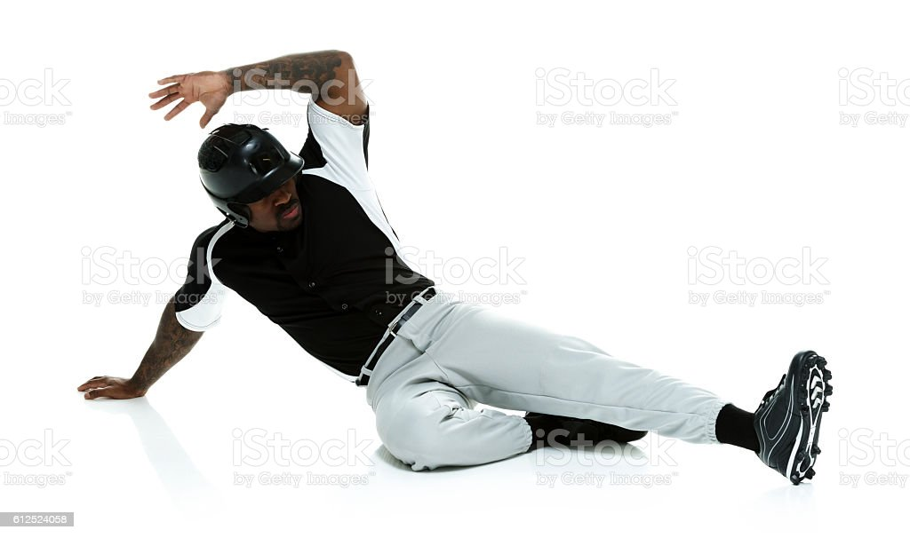 Baseball player sliding stock photo