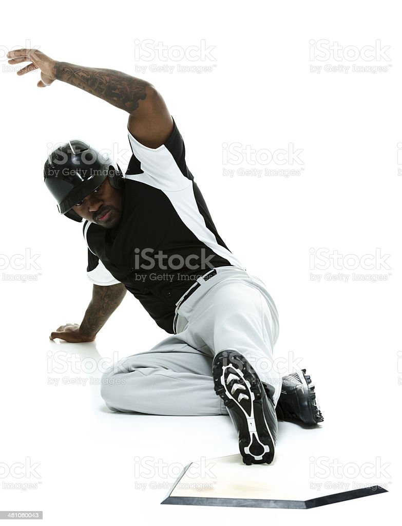 Baseball player sliding to the base stock photo