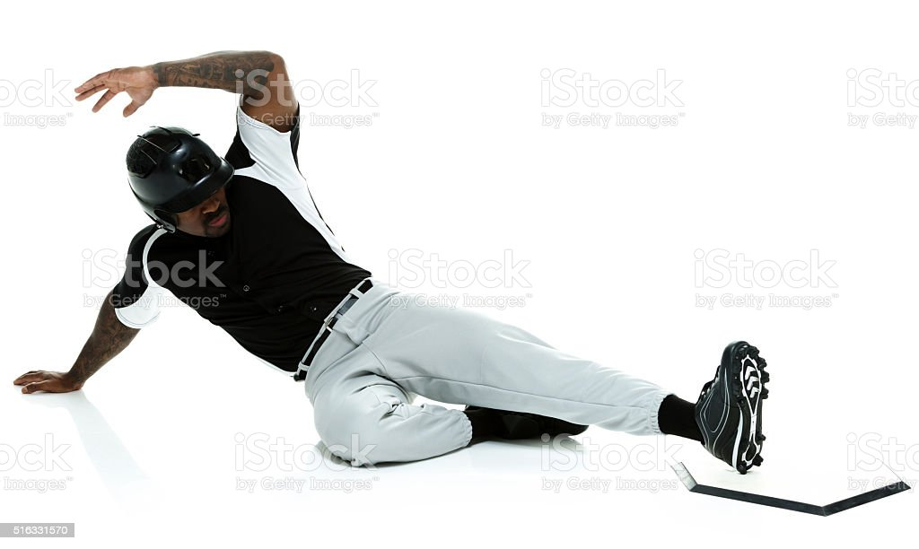 Baseball player sliding to the base stock photo