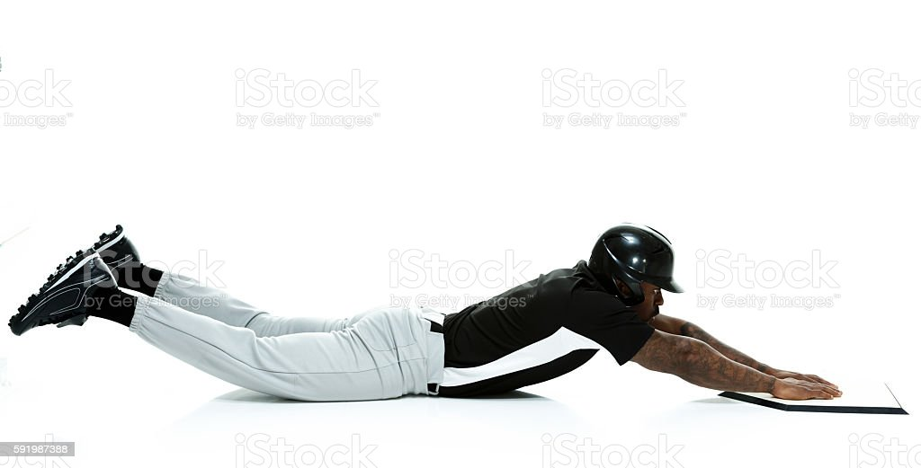 Baseball player sliding towards the base stock photo