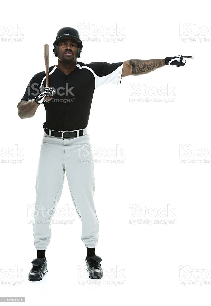 Baseball player standing with bat and pointing stock photo