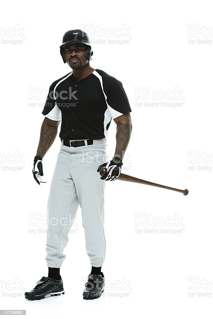 Baseball player standing with bat stock photo