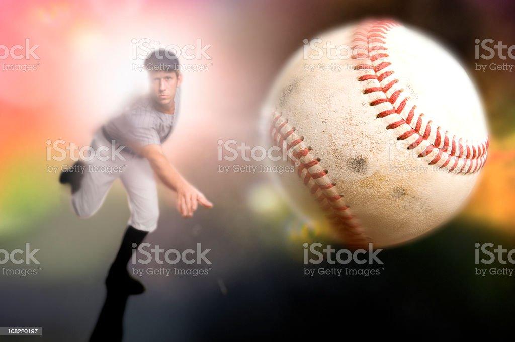 A baseball player throwing a ball stock photo