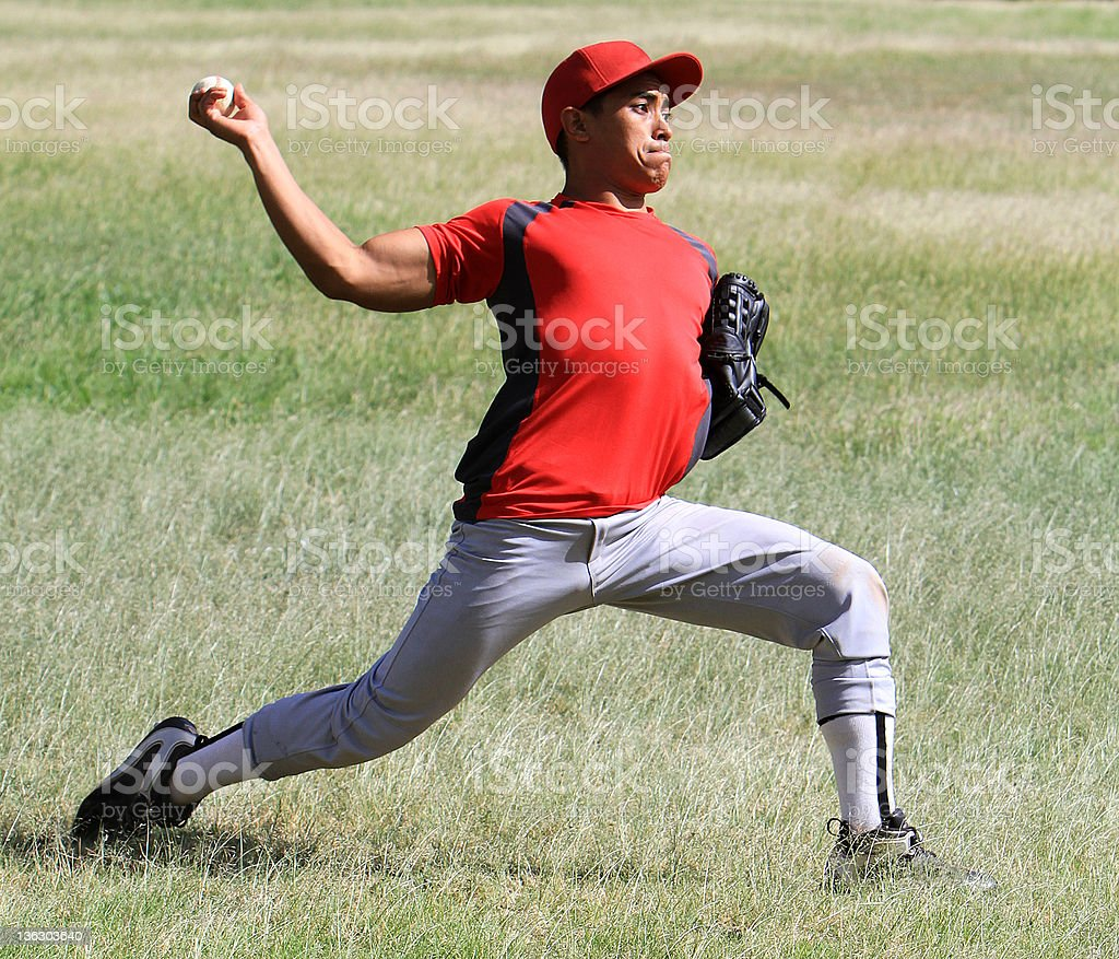 Baseball player throws a ball with strength stock photo