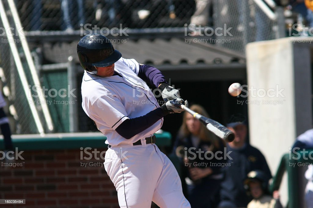 A baseball player up at bat, about to hit the ball stock photo