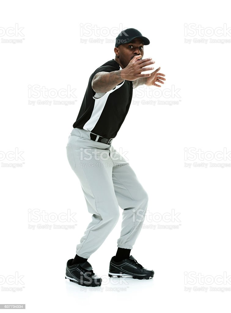 Baseball player waving other to come towards him stock photo