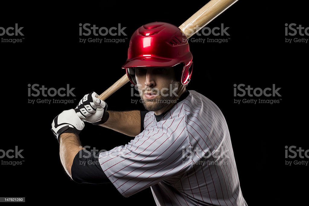 A baseball player wearing a red helmet holding a bat royalty-free stock photo