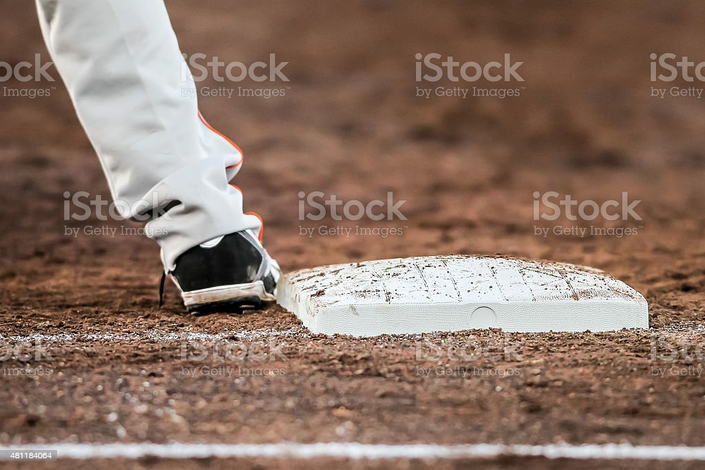 Baseball player with he's feet touching the base plate stock photo